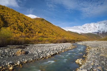 shkhara: Mountain River. Autumn landscape. Inguri River. Mountain Shkhara. Caucasus, Georgia, Zemo Svaneti