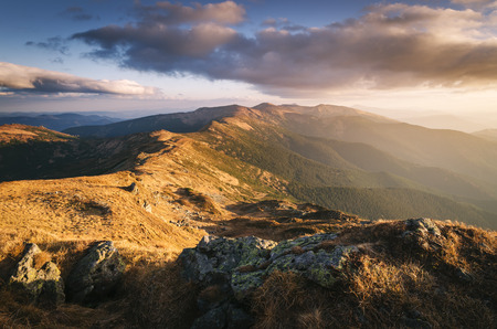 art processing: Mountain ridge. Autumn landscape in the evening sun. View on the tourist route. Carpathians, Ukraine, Europe. Art processing of photos. Color toning