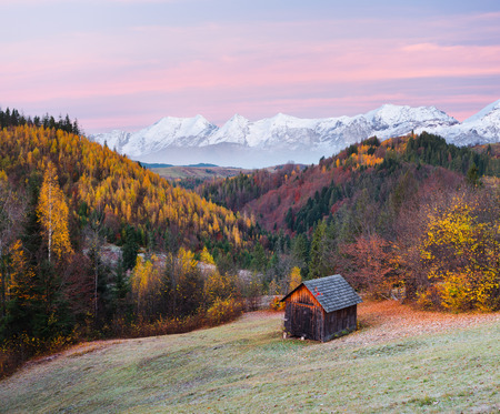 art processing: Wooden cottage in the mountains. Autumn landscape in the countryside. Beautiful forest on the hills. Morning twilight before dawn. Collage of two frames. Art processing photos