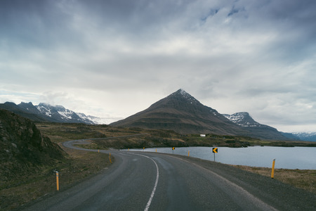 color photographs: Landscape with road and mountains. Cloudy summer day. Southeast Iceland, Europe. Art processing of photographs, color toning