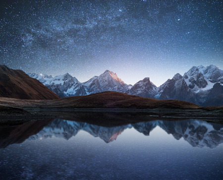 art processing: Night sky with stars and the Milky Way over a mountain lake. Collage of two frames. Art processing photos