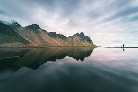 art processing: Amazing landscape of mountains reflected in the water the Bay. View of Cape Stokksnes in the southeastern part of Iceland, Europe. Art processing of photographs, color toning