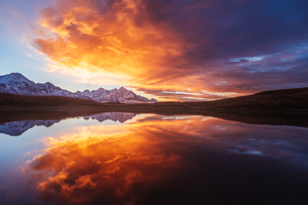 miracles: Mountain Lake. Beautiful sunrise. Morning landscape.  Koruldi Lake. Main Caucasian ridge. Zemo Svaneti, Georgia. Art processing of photos. Color toning Stock Photo