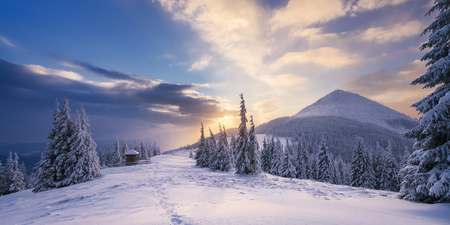 vertex: Winter landscape with a road in the mountains. Sunrise with beautiful clouds. The top and the field. Carpathians, Ukraine, Europe