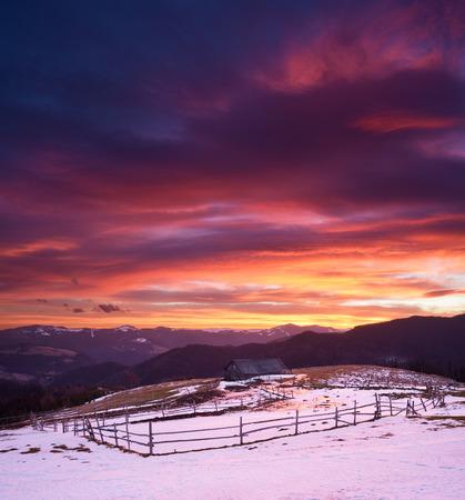 colourful sky: Spring landscape. Colourful sunrise in a mountain village. Sky with beautiful clouds. Carpathians, Ukraine, Europe