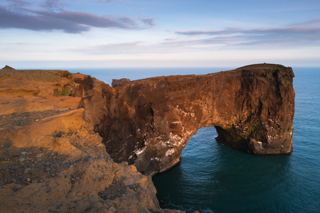 color photographs: Beautiful summer landscape with rocky cape and ocean. Southern coast of Iceland. View of peninsula Dyrholaey, not far from the village V?k. Art processing of photographs, color toning Stock Photo