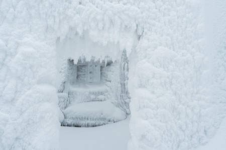 rime frost: Christmas background for design. Room with a window in the frost and snow. Fabulous winter.