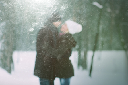 couples hug: Happy couple in nature. Love story. Photo in defocusing. Color toning. The effect of old photos from scuffs and scratches