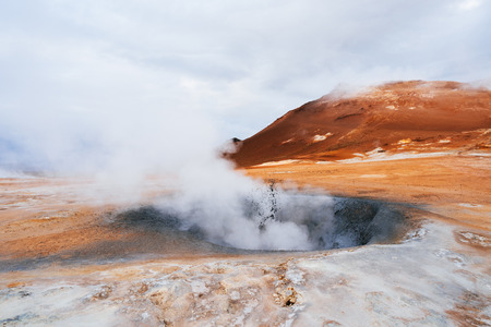 Landscape with eruption steam. Geothermal area Namafjall, Iceland, Europe. Overcast day Imagens