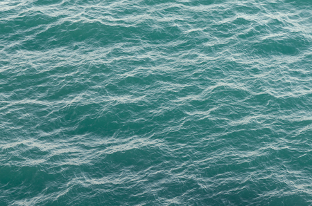 Sea texture. Water surface with waves turquoise. Abstract in nature. Background for design Archivio Fotografico