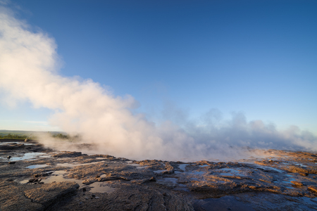 Geyser Strokkur. South western part of Iceland in the geothermal area. Sunny day with clear blue sky. Amazing nature Stock Photo