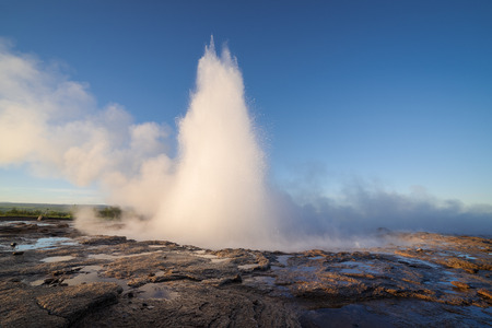 Eruption of the geyser Strokkur. South western part of Iceland in the geothermal area. Sunny day with clear blue sky. Amazing nature