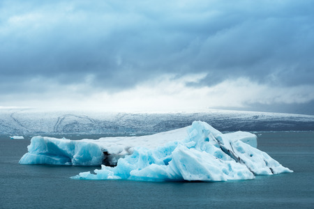 frozen lake: Landscape of Iceland, Europe. Iceberg in the glacial lagoon, located in the southeastern part of the island, near the glacier Vatnajokull. Tourist attraction. Cloudy day in the middle of the month June