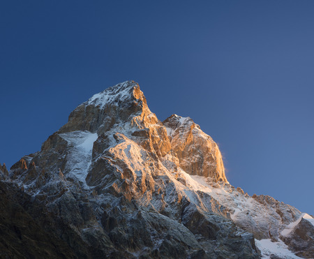 caucas: Mountain top at sunrise. Mount Ushba, Svaneti, Georgia, Caucasus. The first rays of the sun. Beauty in nature