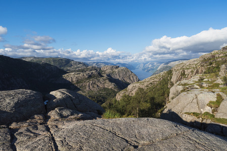 On a pathway Pulpit Rock. View of Lysefjord, Norway