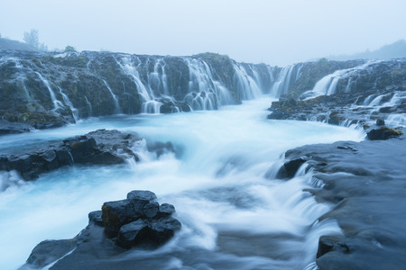 Landscape with an amazing waterfall Bruarfoss. Water is of turquoise color and beautiful cascades