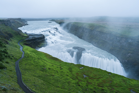 Gullfoss waterfall in the canyon of the mountains. Tourist Attraction Iceland. Beauty in nature