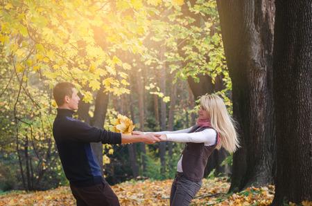 Loving couple is having fun. Walk in the autumn park