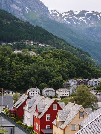 Typical, traditional Scandinavian architecture. Norwegian mountain village in summer. Odda, Norway