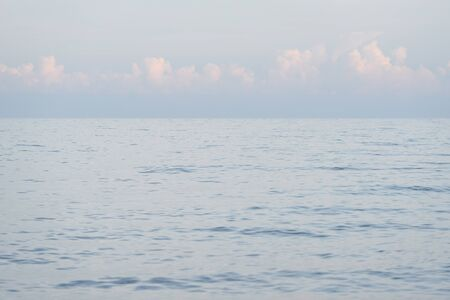 Seascape. Summer background with sea resort. View of the water surface and the horizon