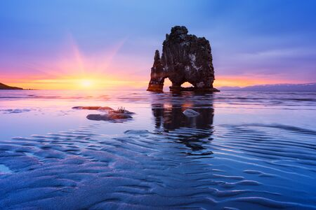 Hvitserkur Sea Stack on ocean in Iceland. Seascape with colorful sunrise