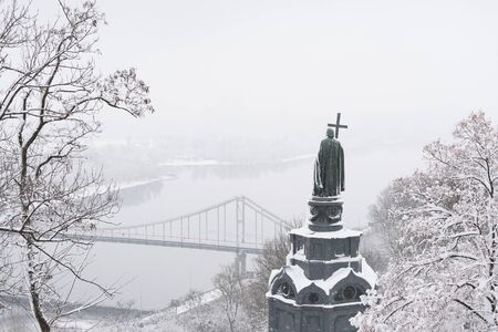 Volodymyr Great Monument. Vladimir Hill Park. View on the Dnipro river, Trukhaniv island. Historic landmark. Winter Kiev (Kyiv), Ukraine