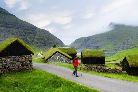 Saksun Village, Streymoy Island, Faroe islands. Old stone houses with a grass (turf) roof. Tourist sightseeing in green valley