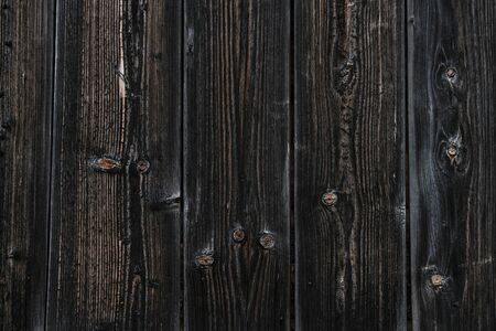 Texture of old wooden boards. Dark natural background