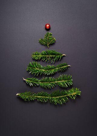 Christmas Greeting Card. Stylized Christmas tree on a black background Stok Fotoğraf