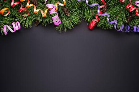 Festive Christmas decoration border. Black background with copy space Stok Fotoğraf