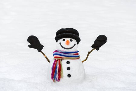 Cheerful snowman with mittens. New Year and Christmas card with a traditional winter character Stok Fotoğraf - 131285197