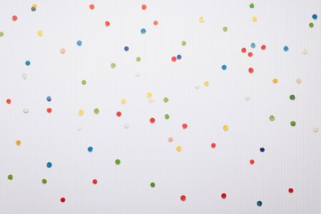 Festive confetti on a white background. Christmas and New Year background with copy space Stok Fotoğraf