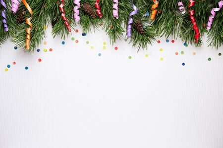 White Christmas and New Year background with pine branches and festive confetti. Copy space for text