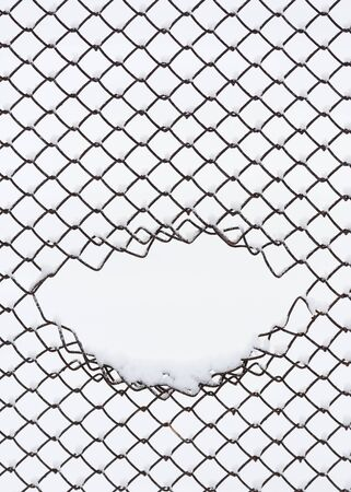 Abstract background with geometric pattern. Metal mesh in the snow Stok Fotoğraf