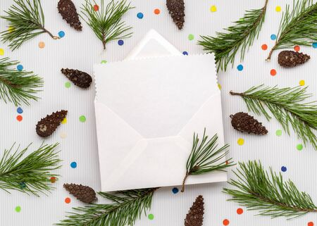 Christmas Greeting Card Letter. White paper sheet with copy space for text. Decor from pine branches and festive confetti Stok Fotoğraf