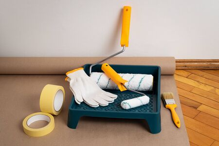 Painting Tools: painter's tape, roller tray, brush and roller systems