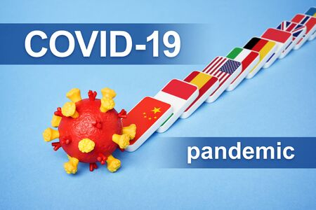 Coronavirus disease COVID-19 Pandemic. Domino effect is a chain reaction of virus spread in the world. Overburdened healthcare system