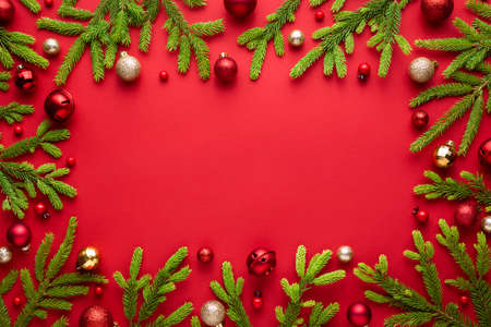 Christmas frame on red background. Top view with copy space for greetings text