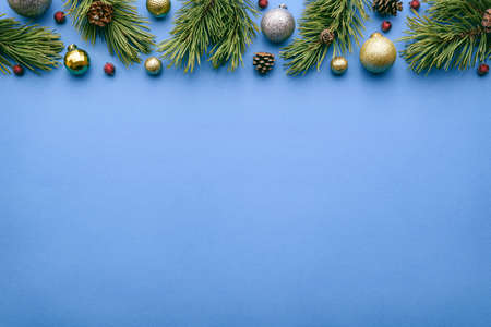 Christmas frame on blue background. Top view and flat lay with copy space for invitation text Archivio Fotografico