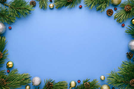 Blue Merry Christmas and Happy New Year background with oval frame. Top view, flat lay with copy space for text Archivio Fotografico