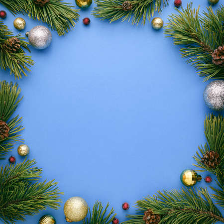 Christmas card with round frame on blue background. New Year banner with copy space. Top view, flat lay
