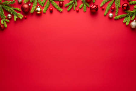 Christmas or New Year red background with fir decor. Blank for advertising text with copy space. Top view, flat lay Archivio Fotografico - 156572279