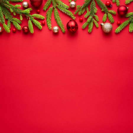 Square christmas card with fir decorations on red background / Blank with copy space for advertising text. Top view, flat lay Archivio Fotografico - 156572614
