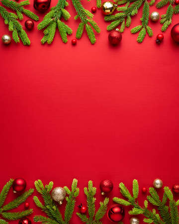Christmas card with festive decor on red background. Festive border with copy space for advertising text Archivio Fotografico - 156572599