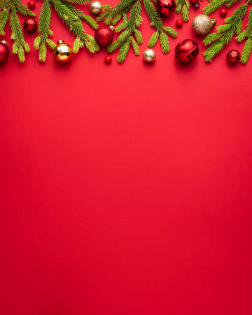 Merry Christmas and Happy New Year red background with holiday decoration. Copy space for message. Top view, flat lay