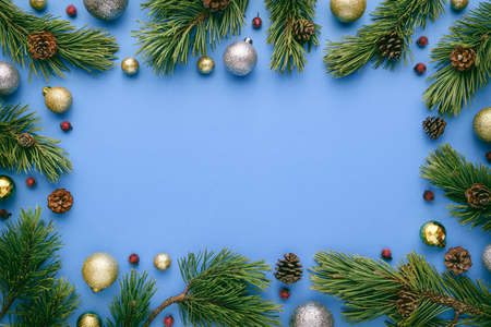 Christmas frame on blue background. Top view with copy space for greetings text