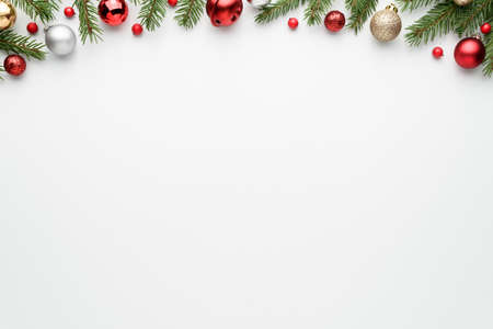White christmas tree background with fir branches and decorations. Happy holidays frame with copy space for festive text. Top view, flat lay Archivio Fotografico