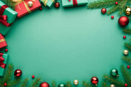 Turquoise christmas background with oval frame. New Year banner with copy space. Top view, flat lay Archivio Fotografico