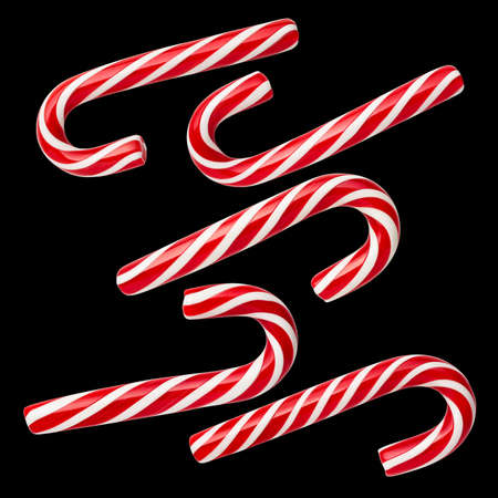 Handmade Peppermint Candy Canes - a holiday tradition. Set of isolated sweets on a black background. No shadow Archivio Fotografico
