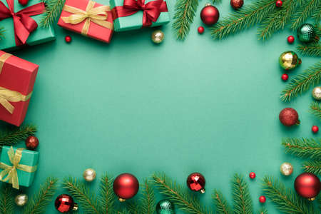 Merry Christmas and Happy New Year frame on turquoise background. Top view, flat lay with copy space for text